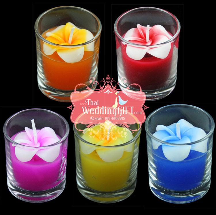 เทียนหอมดอกลีลาวดีบรรจุในแก้วใส แพ็คถุงแก้ว ผูกเชือกพร้อมใบไม้