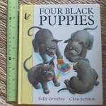 Four Black Puppies